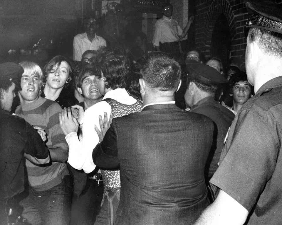 Crowds and police confronted each other outside the Stonewall Inn in 1969.